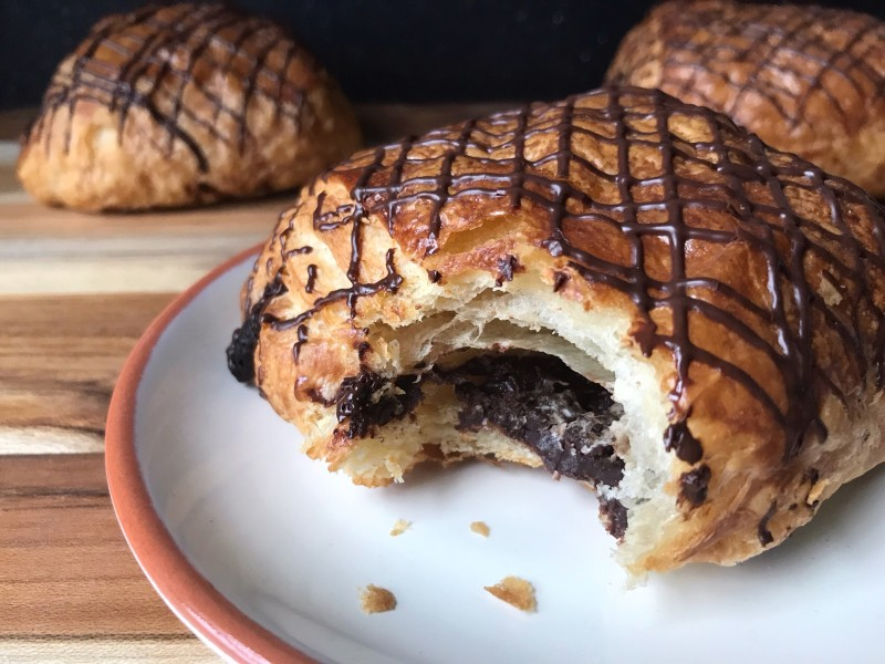 chocolate croissant with a bite out of it
